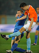 Robin Van Persie of Netherlands injures his right ankle as he is challenged by Giorgio Chiellini of Italy
