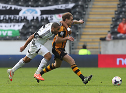 Hull's Nikica Jelavic battles with Swansea's Ashley Williams - Photo mandatory by-line: Matt Bunn/JMP - Tel: Mobile: 07966 386802 05/04/2014 - SPORT - FOOTBALL - KC Stadium - Hull - Hull City v Swansea City- Barclays Premiership