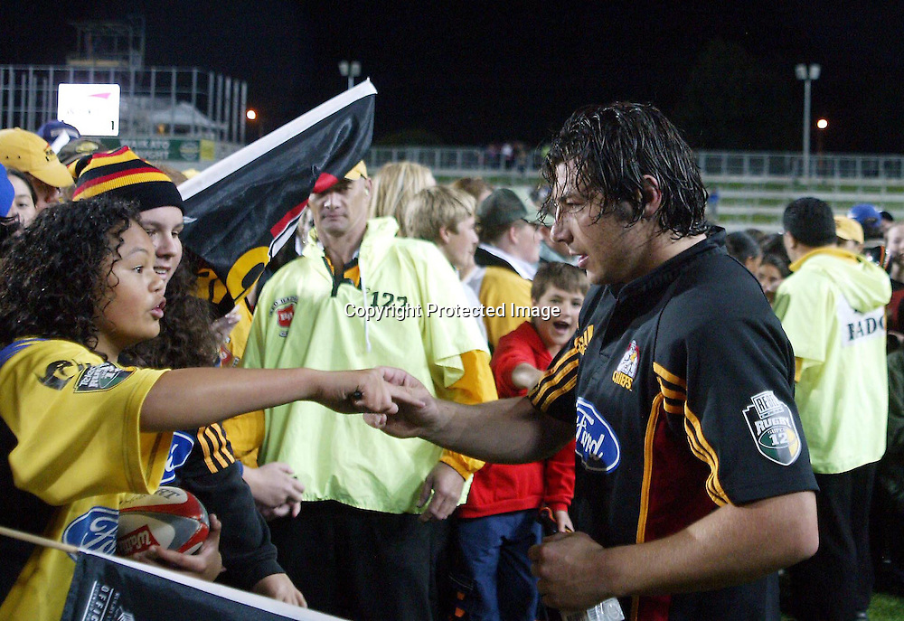 20th February, 2004. Westpac Stadium, Hamilton, New Zealand. Rugby Union Super 12. Chiefs v Hurricanes.<br />Byron Kelleher and Fan.<br />The Chiefs won the match, 19 - 7.<br />Pic: Photosport