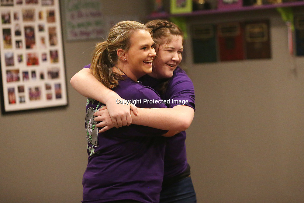 Cloggers Jennifer Vance, 18, left, and Cassidy Irvin, 16, hug after completing their clogging routine in practice at the Steel Toe Magnolias studio in Amory.