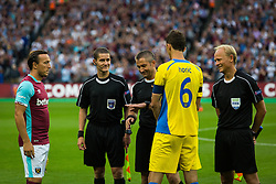 Kenan Horic of NK Domzale, referees and Mark Noble of West Ham during 2nd Leg football match between West Ham United FC and NK Domzale in 3rd Qualifying Round of UEFA Europa league 2016/17 Qualifications, on August 4, 2016 in London, England.  Photo by Ziga Zupan / Sportida