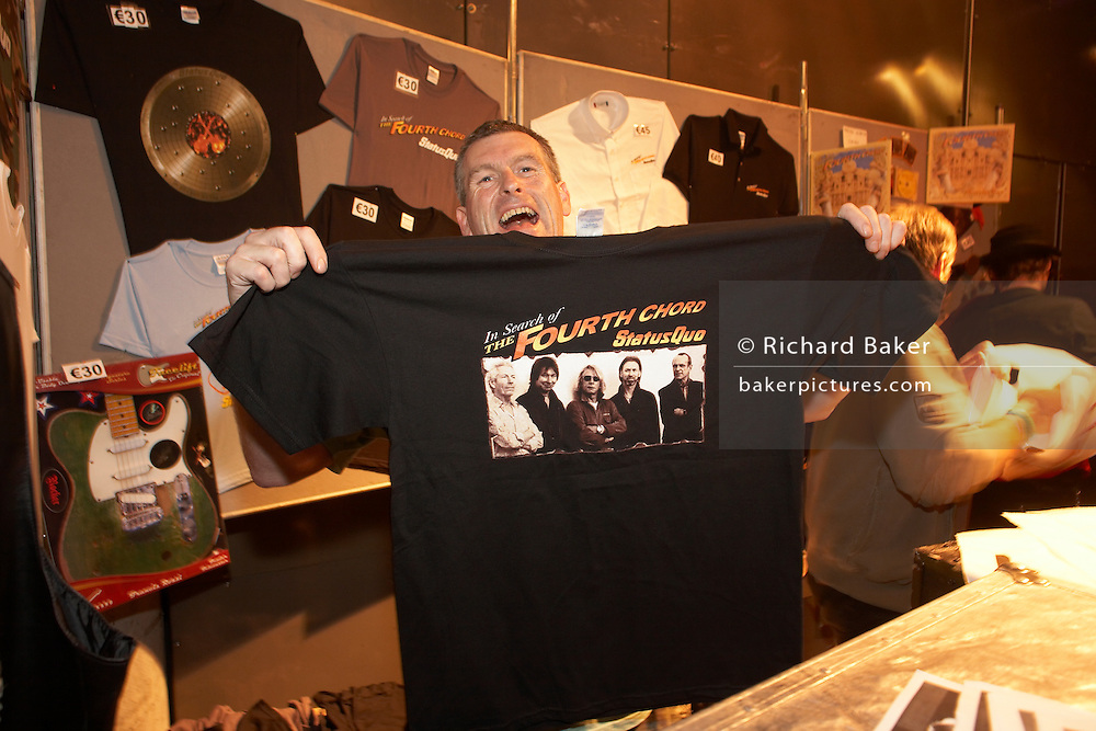Rock band Status Quo merchandising on sale after group's gig at L'Aeronef in Lille, France during group's European tour.