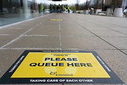 Edinburgh, Scotland, UK. 16 April 2020. Coronavirus lockdown continues in 4th week. Normally busy Ford Kinnaird retail shopping park Is virtually deserted. Signs to help with social distancing in queues at M&S food hall. Iain Masterton/Alamy Live News