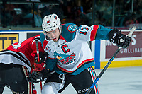 KELOWNA, CANADA - APRIL 14: Rodney Southam #17 of the Kelowna Rockets checks a player of the Portland Winterhawks at the face off on April 14, 2017 at Prospera Place in Kelowna, British Columbia, Canada.  (Photo by Marissa Baecker/Shoot the Breeze)  *** Local Caption ***