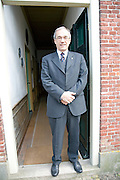 Bank manager in suit standing in doorway of the agricultural co-operative bank in the Baard farmstead, Zuiderzee museum, Enkhuizen, Netherlands. This bank eventually became Rabobank of today.