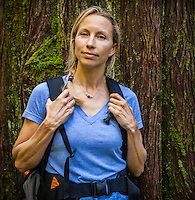 Portrait of a middle aged Caucasian woman wearing a backpack, Little Si trail, Washington, USA.