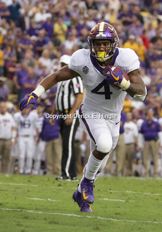 Oct 20, 2018; Baton Rouge, LA, USA; LSU Tigers running back Nick Brossette (4) runs against the Mississippi State Bulldogs during the first quarter at Tiger Stadium. Mandatory Credit: Derick E. Hingle-USA TODAY Sports
