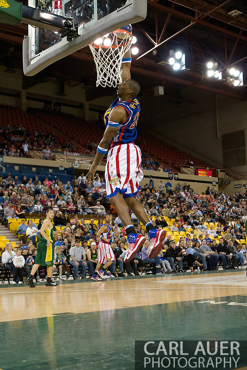 April 30th, 2010 - Anchorage, Alaska: Harlem Globetrotter Hi-Lite Bruton skies to the rim for a second half dunk at the Sullivan Arena.
