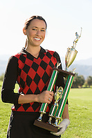 Golf Champion Holding Trophy