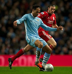 11.01.2012, Etihad Stadion, Manchester, ENG, Carling Cup, Manchester City vs FC Liverpool, Halbfinale, im Bild Liverpool's Andy Carroll in action against Manchester City's Joleon Lescott during the football match of English Carling Cup, Halffinal, between Manchester City and FC Liverpool at Etihad Stadium, Manchester, United Kingdom on 2012/01/11. EXPA Pictures © 2012, PhotoCredit: EXPA/ Propagandaphoto/ David Rawcliff..***** ATTENTION - OUT OF ENG, GBR, UK *****