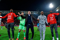 Jeroen Zoet #1 of FC Utrecht, Coach John van den Brom # of FC Utrecht, Jean-Christophe Bahebeck #9 of FC Utrecht, Lamine Sane #20 of FC Utrecht celebrate after the semi final KNVB Cup between FC Utrecht and Ajax Amsterdam at Stadion Nieuw Galgenwaard on March 04, 2020 in Amsterdam, Netherlands