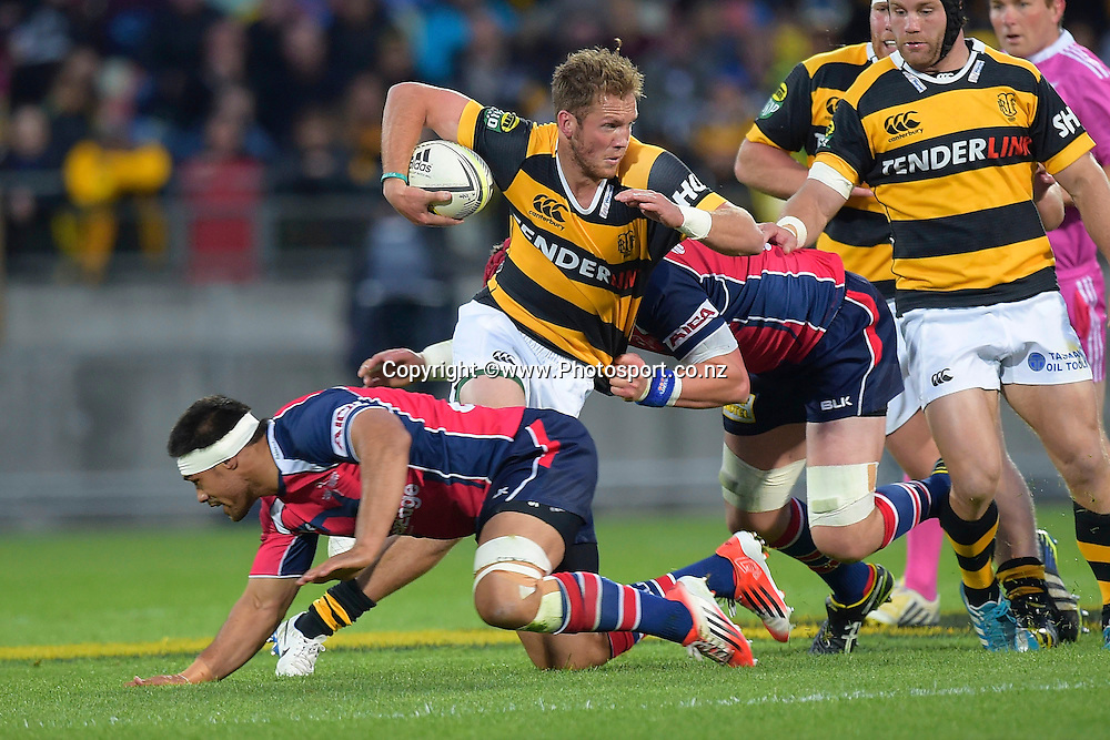 Taranaki's Marty McKenzie (C is tackled by Tasman Makos Joe Wheeler and Shane Christie during the ITM Cup Premiership Final between Taranaki & Tasman at Yarrow Stadium in New Plymouth, New Zealand, 25th October 2014. Photo: Marty Melville/Photosport.co.nz