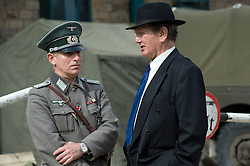 Re-enactors dressed as a German medical Officer chats with a 1940s civilian during the the Elsecar Heritage Centre 1940s Wartime Weekend 4 September 2010 .Images © Paul David Drabble..