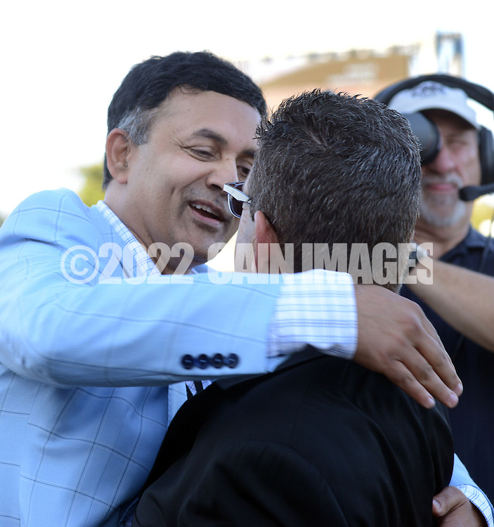 BENSALEM, PA - SEPTEMBER 20: Bayern owner Kaleem Shah (L) is congratulated after winning the Pennsylvania Derby September 20, 2014 at Parx Racing in Bensalem Pennsylvania. Bayern set the Parx track record for 1 1/8 miles at 1:46.96. (Photo by William Thomas Cain/Cain Images)