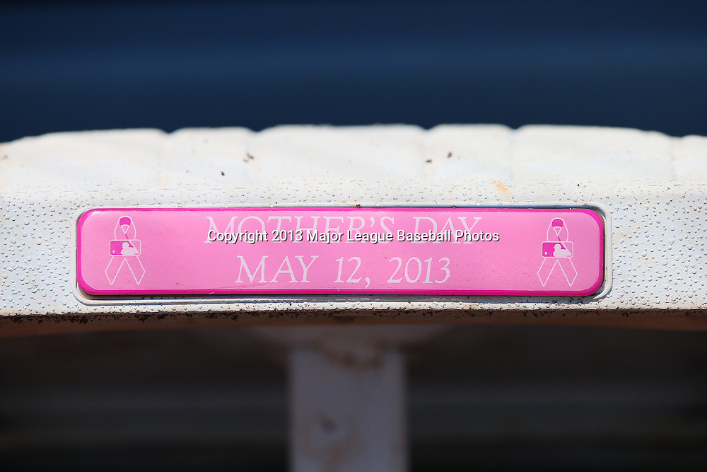 LOS ANGELES, CA - MAY 12:  A base features the date on a pink Mother's Day plaque in honor of Mother's Day before the game against the Miami Marlins on Sunday, May 12, 2013 at Dodger Stadium in Los Angeles, California. The Dodgers won the game 5-3. (Photo by Paul Spinelli/MLB Photos via Getty Images)