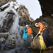 """Freyr Ingi Björnsson, Viðar Helgasson og Viktor Þór Jörgensson below the ice climb """"Álið er málið"""" WI4  at Þórólfsárgili, Fljótshlíð."""