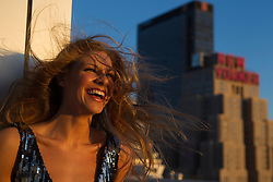 woman enjoying the wind in her hair in New York City at sunset