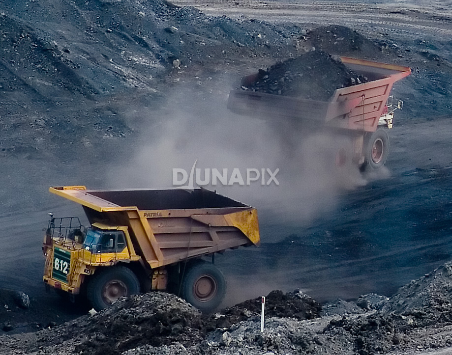 Giant mining trucks at Kaltim Prima Coal mine, Sangatta. This mine supplies the export facility at Tanjung Bara.