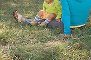 mother with child sitting in the grass