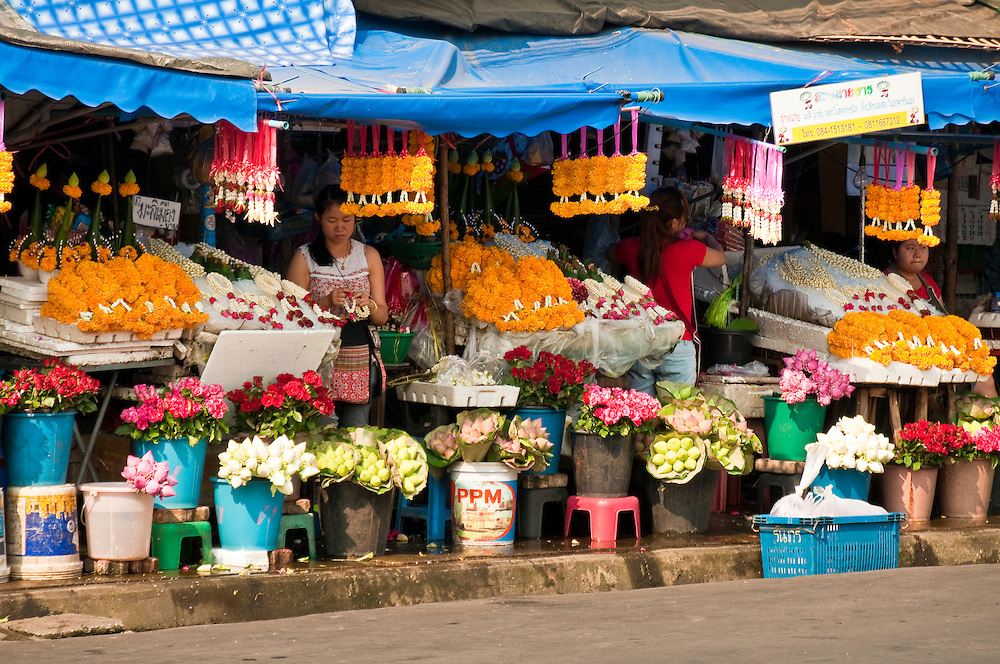 Flower vendors at marketplace near Chinatown and Ping River, Chiang Mai, Thailand.