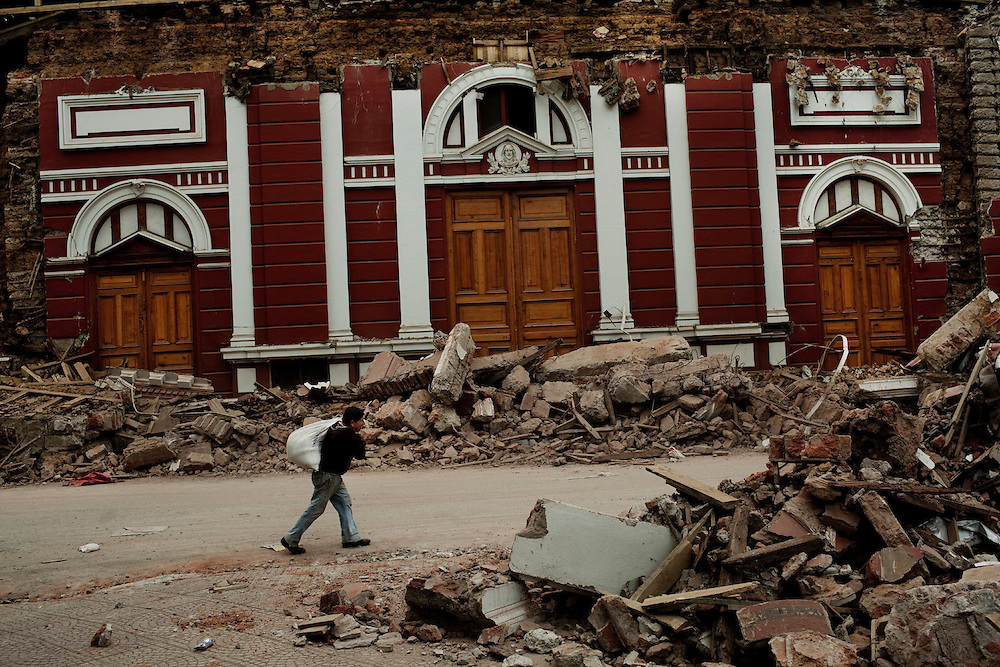A man walks past the main church destroyed by the earthquake in Constitucion, Chile, Feb 28, 2010.