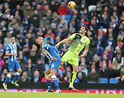 Huddersfield Town defender Mark Hudson (5) and Brighton striker, Bobby Zamora (25) Brighton and Hove Albion and Huddersfield Town at the American Express Community Stadium, Brighton and Hove, England on 23 January 2016.