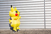UNITED KINGDOM, London: 27 October 2017 A cosplay fan dressed as Pikachu walks toward the MCM London Comic Con. The convention, which runs all this weekend at the Excel Centre, will see thousands of cosplay and comic book fans visit the venue. Rick Findler / Story Picture Agency