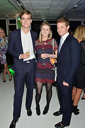 Left to right, MYLO SANGSTER, GEORGINA FERGUSON and JAMES FERGUSON at the London premier of Being AP held at Altitude 360, Millbank Tower, 30 Millbank, London on 23rd November 2015.
