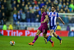 WIGAN, ENGLAND - Monday, February 19, 2018: Manchester City's Danilo Luiz da Silva and Wigan Athletic's Will Grigg during the FA Cup 5th Round match between Wigan Athletic FC and Manchester City FC at the DW Stadium. (Pic by David Rawcliffe/Propaganda)