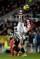 Photo: Jed Wee.<br /> Newcastle United v Charlton Athletic. The Barclays Premiership. 22/02/2006.<br /> <br /> Charlton's Chris Perry is flipped upsidedown by Newcastle's Emre.