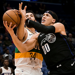 Feb 12, 2019; New Orleans, LA, USA; Orlando Magic forward Aaron Gordon (00) drives past New Orleans Pelicans guard Kenrich Williams (34) during the second half at the Smoothie King Center. Mandatory Credit: Derick E. Hingle-USA TODAY Sports
