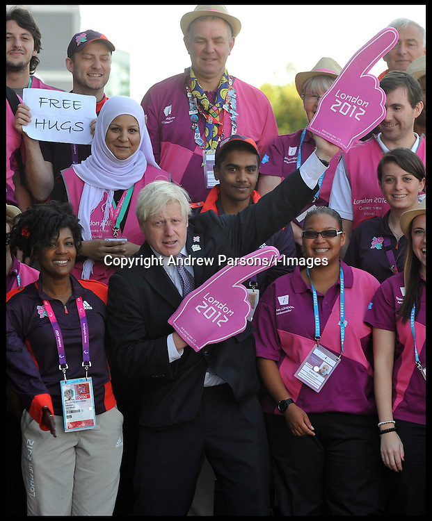London Mayor Boris Johnson performs a Usain Bolt style celebration as he meets London 2012 volunteering heroes, at the O2 in London, Thursday September 6, 2012 Photo Andrew Parsons/i-Images..All Rights Reserved ©Andrew Parsons/i-Images