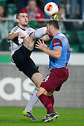 (L) Legia's Michal Kucharczyk fights for the ball with (R) Tabzonspor's Aykut Demir during the UEFA Europa League Group J football match between Legia Warsaw and Trabzonspor AS at Pepsi Arena Stadium in Warsaw on November 07, 2013.<br /> <br /> Poland, Warsaw, November 07, 2013<br /> <br /> Picture also available in RAW (NEF) or TIFF format on special request.<br /> <br /> For editorial use only. Any commercial or promotional use requires permission.<br /> <br /> Mandatory credit:<br /> Photo by &copy; Adam Nurkiewicz / Mediasport