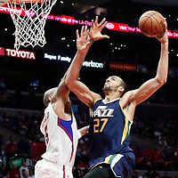 25 March 2016: Utah Jazz center Rudy Gobert (27) goes for the dunk over LA Clippers center Marreese Speights (5) during the Los Angeles Clippers 108-95 victory over the Utah Jazz, at the Staples Center, Los Angeles, California, USA.