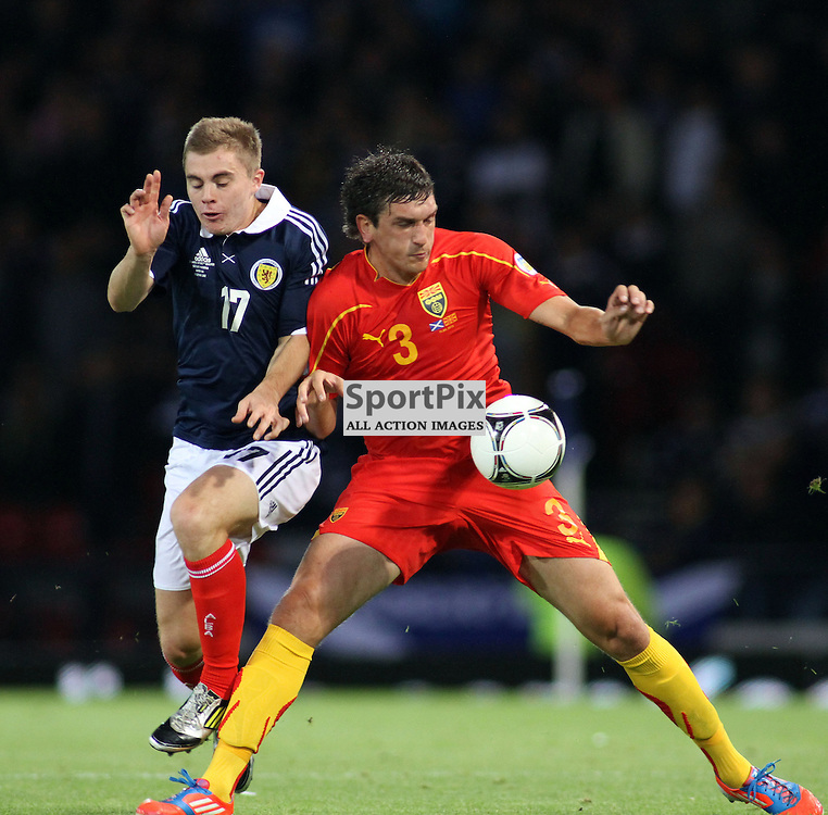 James Forrest scotland tangles with Goran Popov macedonia in the .FIFA World Cup Qualifier scotland v macedonia, hampden stadium, glasgow .Kevin McGlynn(c)  | StockPix.eu.