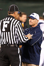 January 9, 2011; San Francisco, CA, USA;  Nevada Wolf Pack head coach Chris Ault (right) talks to field judge Randy Smith (left) before the 2011 Fight Hunger Bowl against the Boston College Eagles at AT&T Park. Nevada defeated BC 20-13.