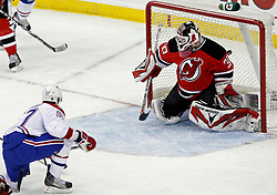 Jan 22, 2010; Newark, NJ, USA; Montreal Canadiens left wing Benoit Pouliot (57) scores a goal on New Jersey Devils goalie Martin Brodeur (30) during the first period at the Prudential Center.
