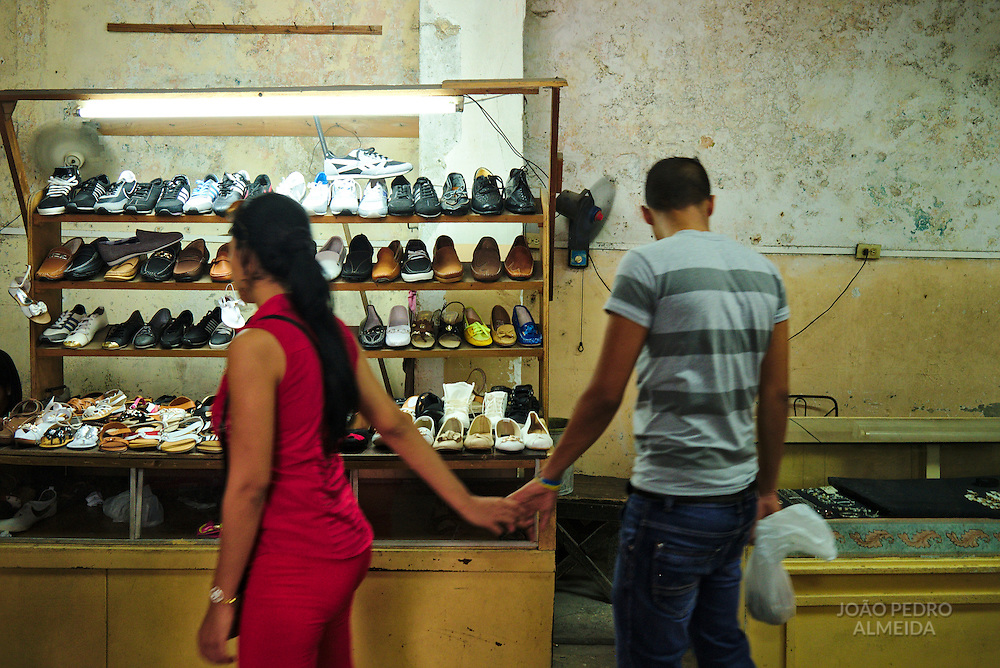Couple browsing in a shoe shop.