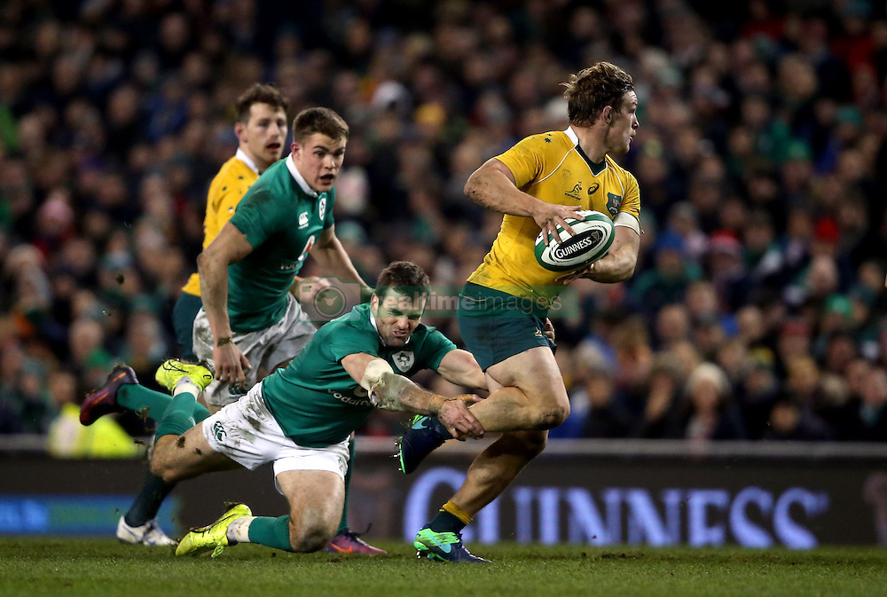 Australia's Michael Hooper is tackled by Ireland's Jared Payne during the Autumn International match at the Aviva Stadium, Dublin.