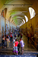 This museum is named after Pope Pius VII (whose last name was Chiaramonti before his election as pope), who founded it in the early 19th century. The museum consists of a large arched gallery in which sides are exhibited several statues, sarcophaguses and friezes. The New Wing, Braccio Nuovo built by Raphael Stern, houses important statues like The Prima Porta Augustus, Doryphorus, and The River Nile. Galeria Lapidaria is another part of Chiaramonti museum, with more than 3,000 stone tablets and inscriptions, which is the world's greatest collection of its kind.