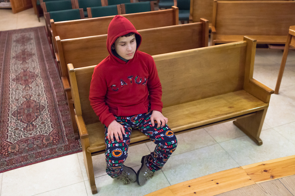 Hazem is fifteen years old and was born both deaf and blind. He likes to go to church, where he prays in special sign language for the deafblind (Jordan, 2014). © Guido Dingemans. Licensed by the Holy Land Institute for the Deaf (2014).