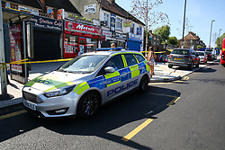 © Licensed to London News Pictures. 14/09/2019. London, UK. A crime scene on Downham Way in Lewisham as a murder investigation has been launched by Met Police after a 34 years old man died in hospital. The victim suffered stab and head wounds on Friday 13 Sept following a fight inside Metro chicken shop on Downham way. A 51 year old man was also injured in the fight and has since been discharged from hospital and subsequently arrested in suspicion murder. Two other men aged 40 and 46 have also been arrested on suspicion murder. Photo credit: Dinendra Haria/LNP