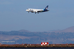 Embraer ERJ-175LR (N175SY) operated by SkyWest Airlines for Alaska Airlines landing at San Francisco International Airport (KSFO), San Francisco, California, United States of America