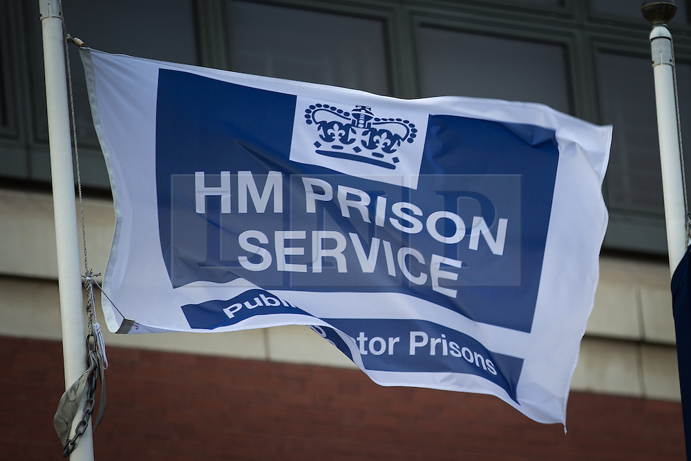 © Licensed to London News Pictures . File picture of HMP Manchester ( formerly Strangeways ) - HM Prison Service flag outside the front entrance . Photo credit : Joel Goodman/LNP