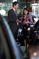 Car salesman explaining car features to customer