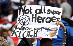 Derby County fan holds up a sign for Derby County's Richard Keogh before the game