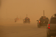 Vice President Joe Biden's motorcade travels through a sandstorm at Baghdad International airport, in Baghdad, Iraq, Saturday, July 4, 2009. (Official White House Photo by David Lienemann)