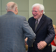 Former Texas governor Mark White, right, greets former Houston ISD superintendent Billy Reagan during a Board of Education meeting, June 12, 2014.
