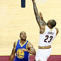 10 June 2016: Cleveland Cavaliers forward LeBron James (23) goes for the layup over Golden State Warriors forward Andre Iguodala (9) during the Golden State Warriors 108-97 victory over the Cleveland Cavaliers, during Game Four of the 2016 NBA Finals at the Quicken Loans Arena, Cleveland, Ohio, USA.