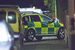 © Licensed to London News Pictures . 12/10/2015 . Eccles , UK . An ambulance on the scene on Gillingham Road , Eccles where it's reported a woman and a child were both shot this evening (12th October 2015) . It's reported the victims are a woman and her young son who were shot in the legs . It's the fifth shooting in Manchester in under a week . Photo credit : Joel Goodman/LNP